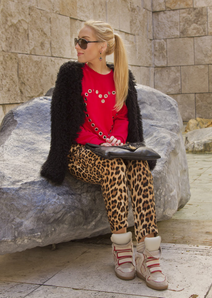 animal print pants with red sweater