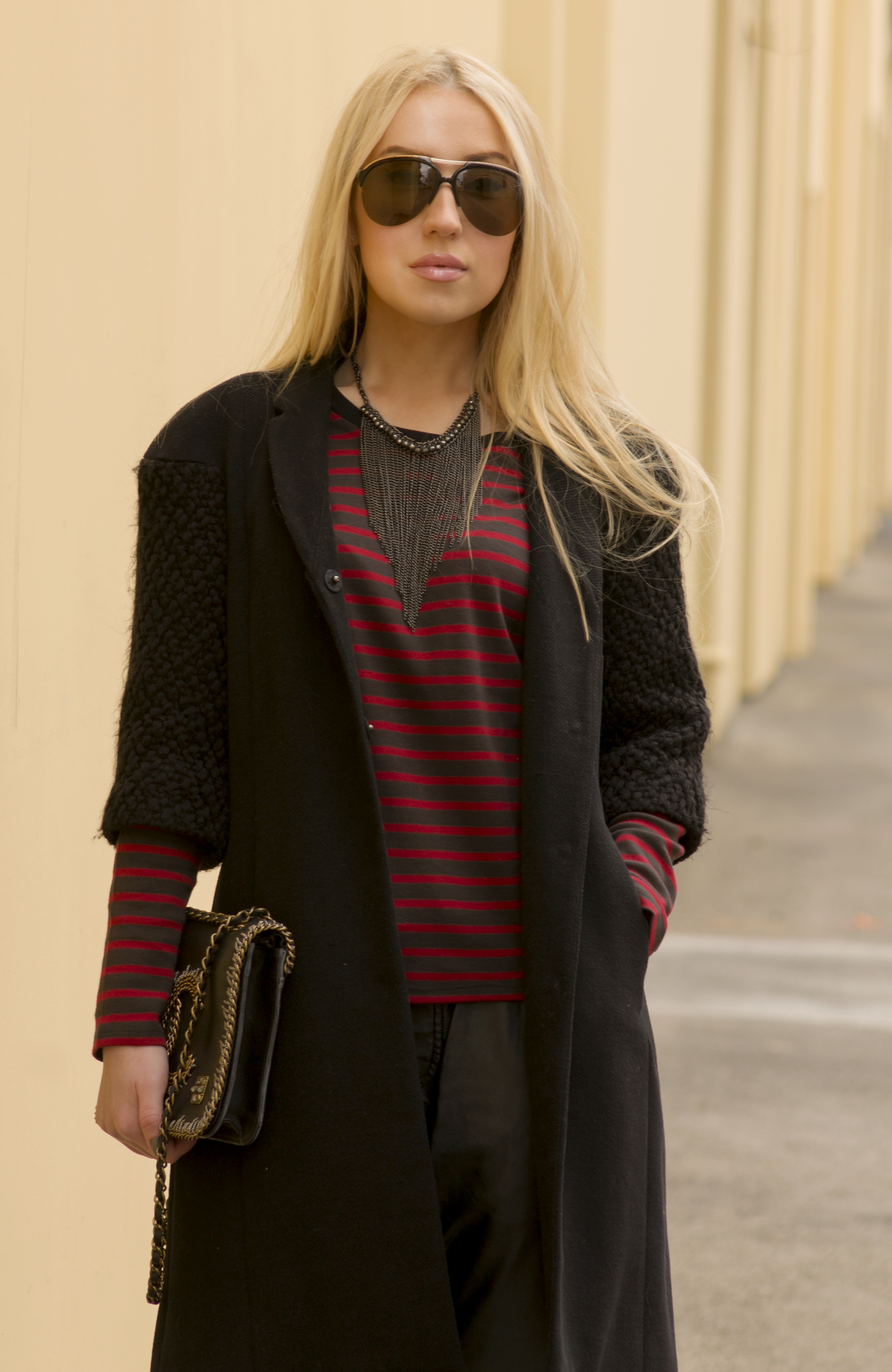 black coat and necklace