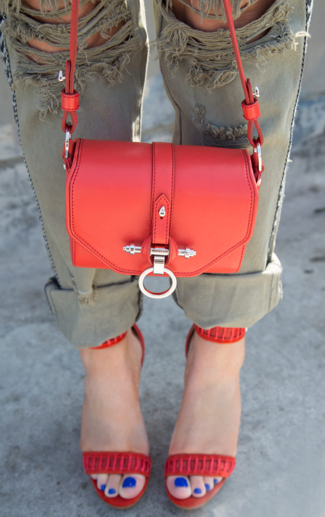 khaki and red,red obsedia bag,ripped jeans