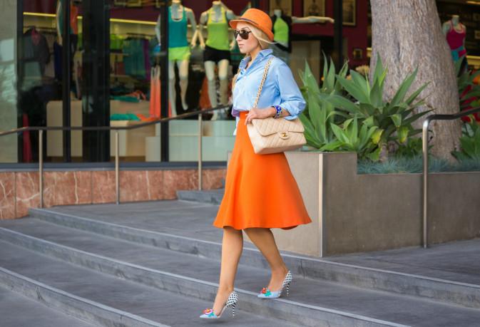 midi skirt outfit,midi skirt trend,orange skirt,sophia webster pumps