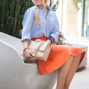 orange and blue outfit,chanel bag,orange hat