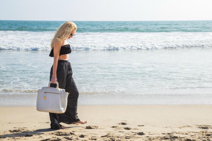 polka dot beach outfit,zara wide leg pants,polka dot pants,prada tote,zara bustier top,polka dots on the beach