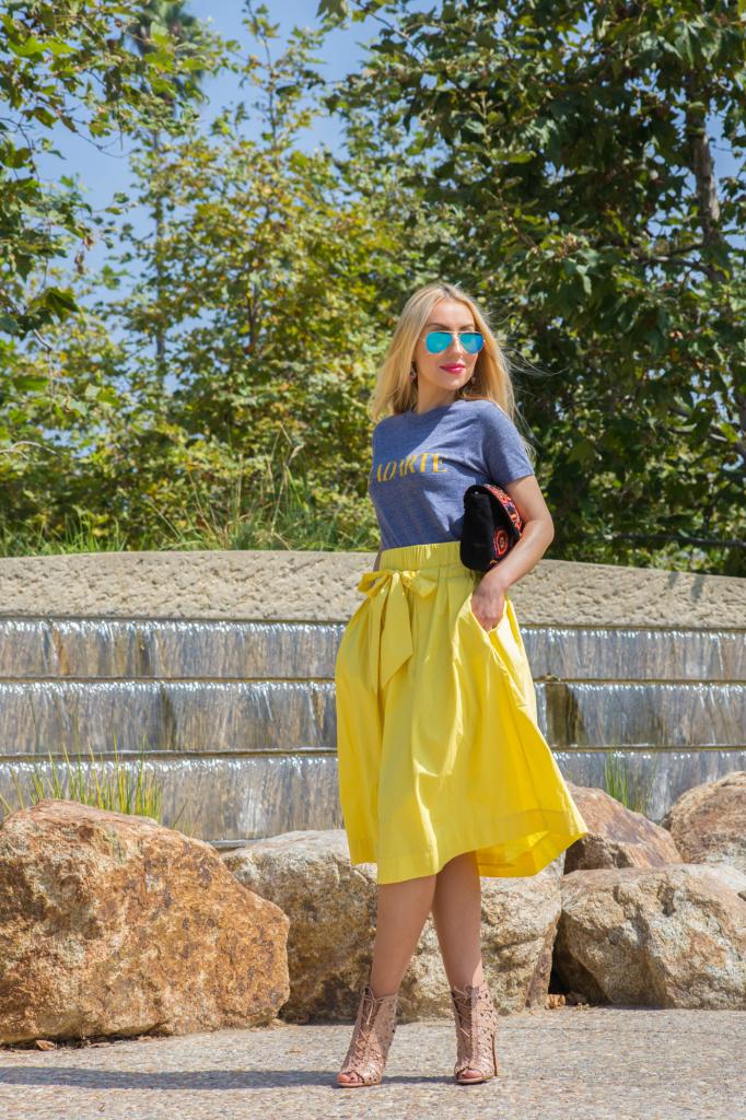 blue and yellow outfit,antic batik basra clutch,alaia booties,shine bright,logo trend,alaia shoes,radarte t-shirt,ray ban mirror aviators,ray ban mirror aviators,antic batik clutch,yellow midi skirt,rodarte t-shirt