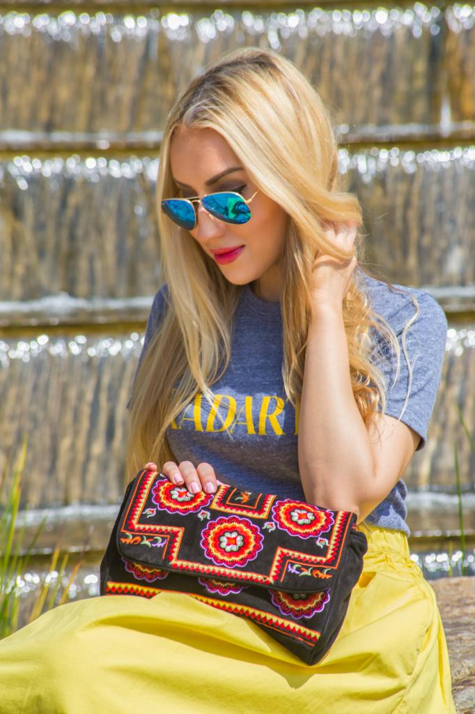 blue and yellow outfit,antik batik badra clutch,alaia booties,logo trend,alaia shoes,radarte t-shirt,ray ban mirror aviators,ray ban mirror aviators,antik batik clutch,yellow midi skirt,rodarte t-shirt