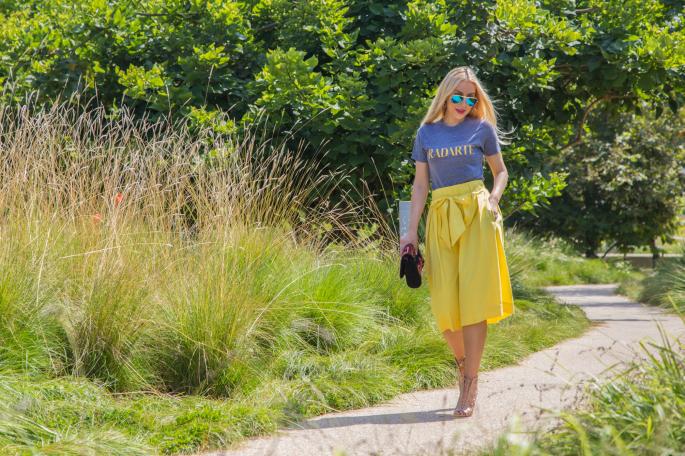 yellow midi skirt,blue and yellow outfit,antik batik badra clutch,alaia booties,logo trend,alaia shoes,radarte t-shirt,ray ban mirror aviators,ray ban mirror aviators,antik batik clutch,rodarte t-shirt