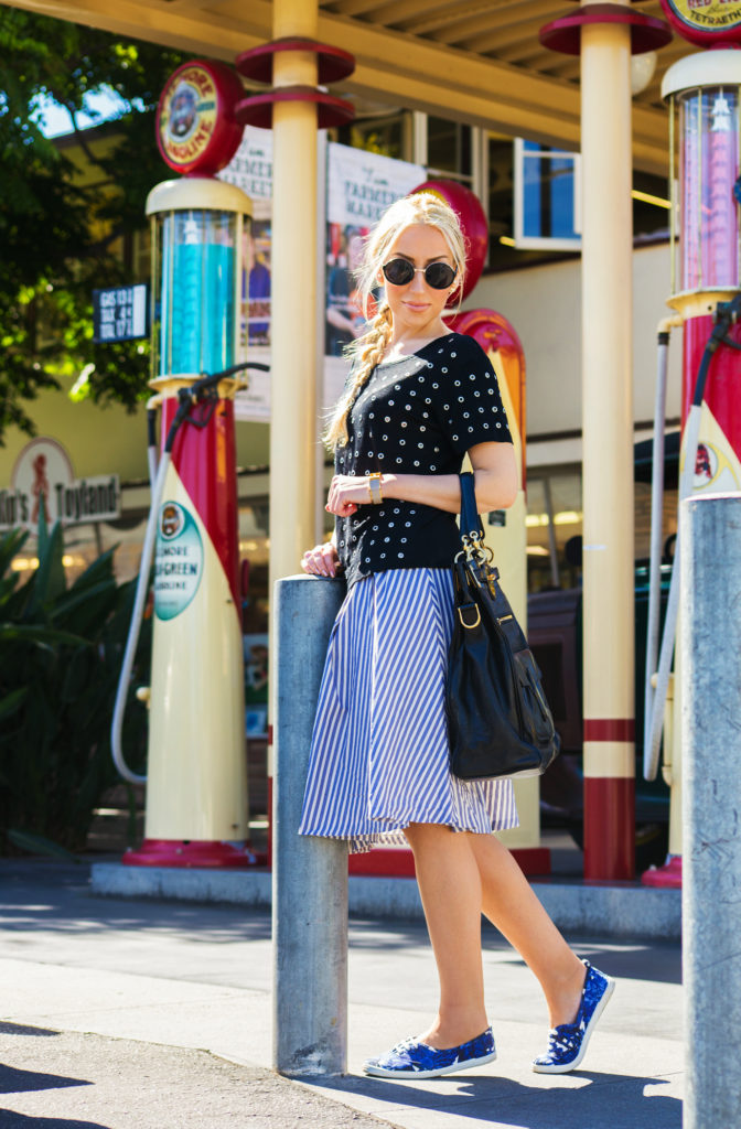 balenciaga bag,zara midi skirt, black and blue outfit, skirt and sneakers outfit,studded t-shirt,embellished t-shirt,maje top, black embellished top,dior en miss earrings, make t-shirt,asos sunglasses
