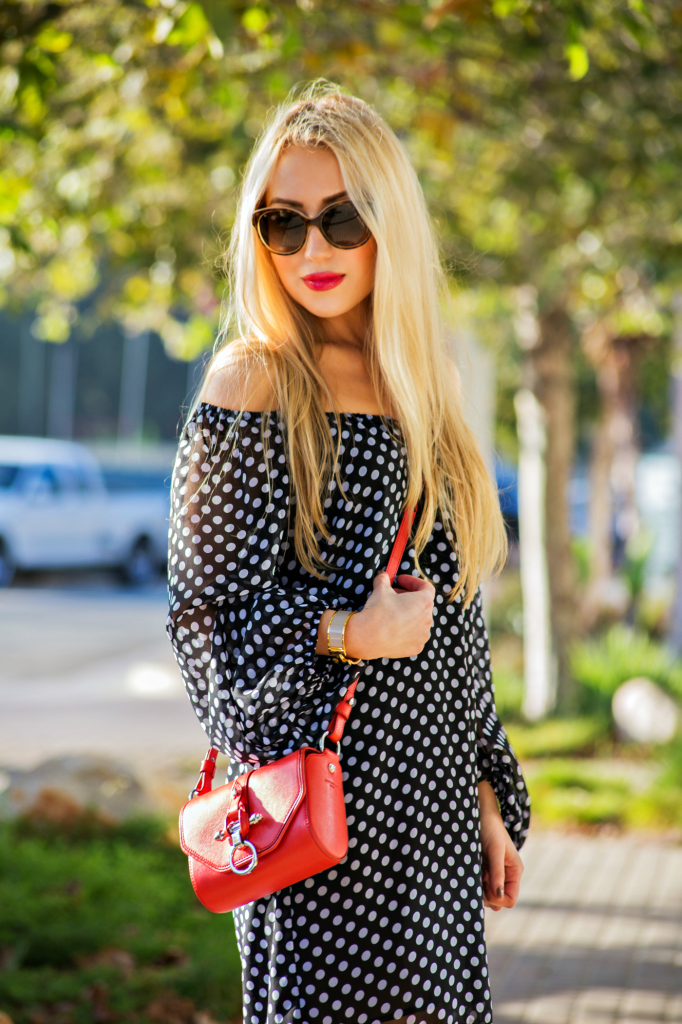 red and polka dot,polka dot dress,off the shoulder polka dot dress,givenchy obsedia bag,red cross body bag,fendi sandals,gold hardware sandals,dress with tassel,tasseled dress,miu miu sunglasses