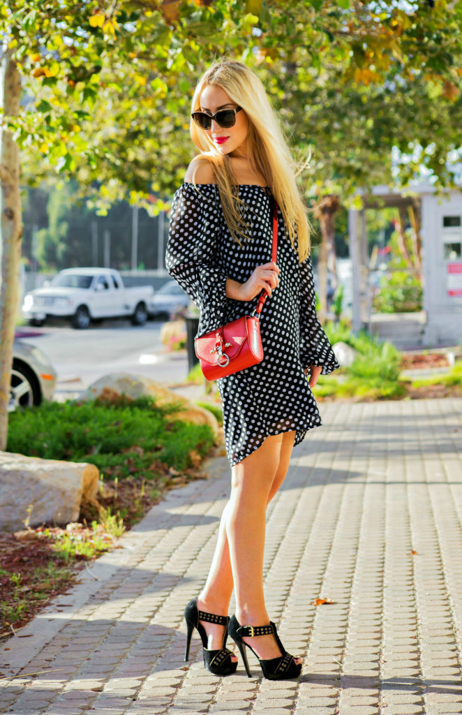 red and polka dot,polka dot dress,off the shoulder polka dot dress,givenchy obsedia bag,red cross body bag,fendi sandals,gold hardware sandals,dress with tassel,tasseled dress