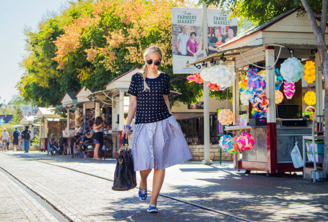 balenciaga bag,zara midi skirt, black and blue outfit, skirt and sneakers outfit,studded t-shirt,embellished t-shirt,maje top, black embellished top,dior en miss earrings, make t-shirt,asos sunglasses,weekend outfit
