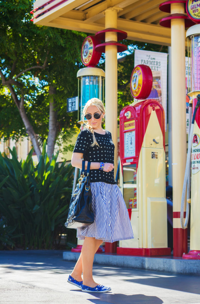 balenciaga bag,zara midi skirt, black and blue outfit, weekend outfit, skirt and sneakers outfit,studded t-shirt,embellished t-shirt,maje top, black embellished top,dior en miss earrings, make t-shirt,asos sunglasses