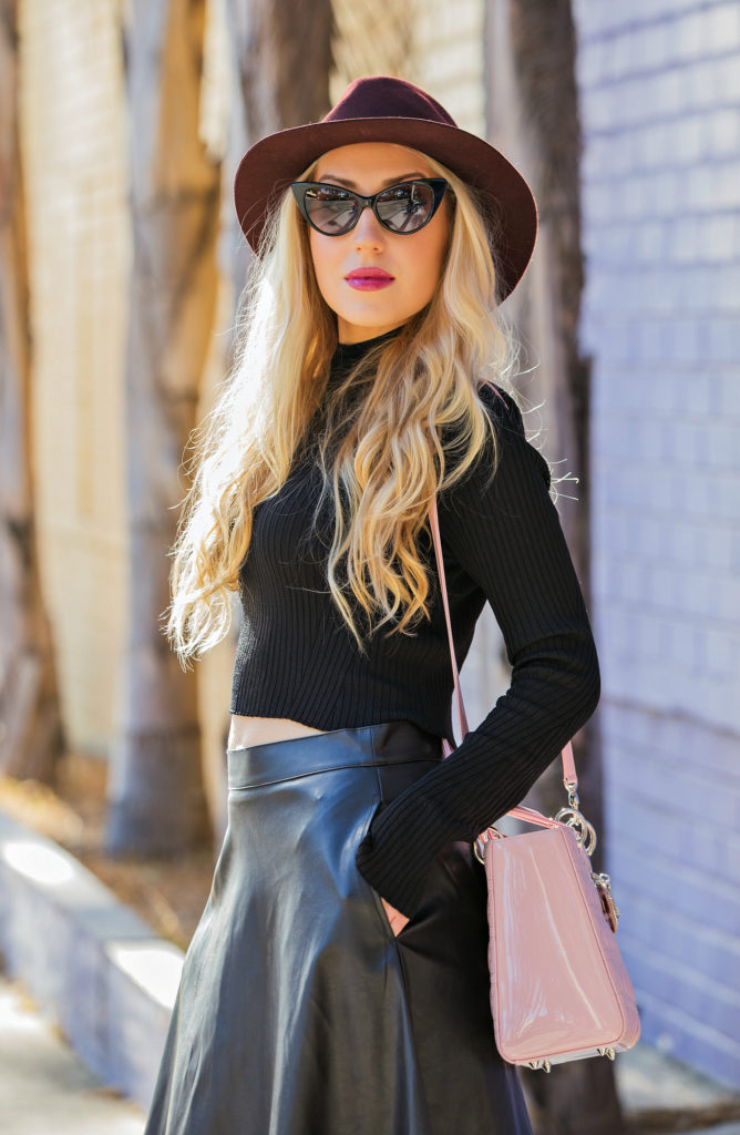 casadei blade boots,black cropped sweater,rag and bone fedora hat,tom ford nikita cat eye sunglasses,casadei booties,faux leather midi skirt,zara cropped sweater,lady dior bag,casadei boots and lady dior bag