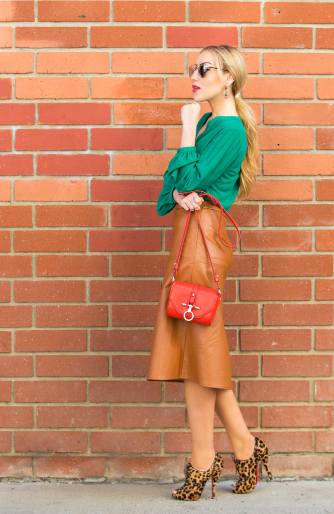 leopard print shoes,70s inspired outfit,Tan Leather Skirt,how to wear tan  leather midi skirt,70s inspired look,Christian Louboutin Lady Derby,Christian Louboutin Leopard booties,Dior So real sunglasses,Dior So Real,How to wear red and green,That 70s