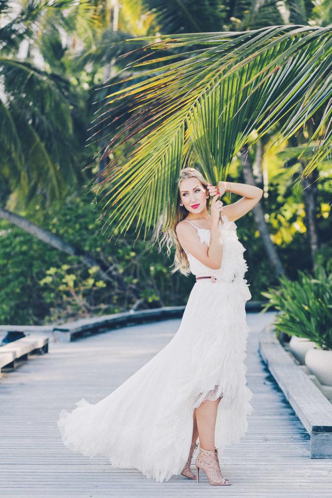 nina ricci ruffle white dress,W Hotel Maldives photo shoot,W hotel Maldives,Dior Bracelet,Nina Ricci dress,destination photography,travel photography,maldives,alaia boots,alaia sandals,alaia lace up,dior jewelry,dior earrings ,dior bracelet
