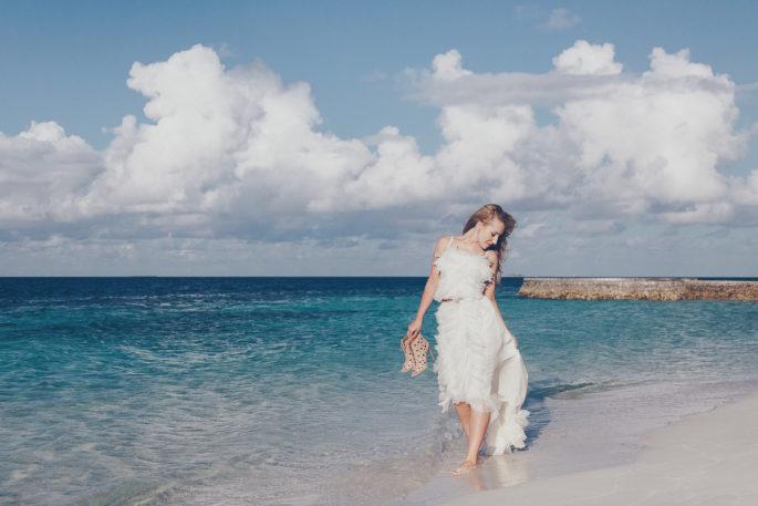 On cloud nine,nina ricci ruffle white dress,W Hotel Maldives photo shoot,W hotel Maldives,Dior Bracelet,Nina Ricci dress,destination photography,travel photography,maldives,alaia boots,alaia sandals,alaia lace up,dior jewelry,dior earrings ,dior bracelet