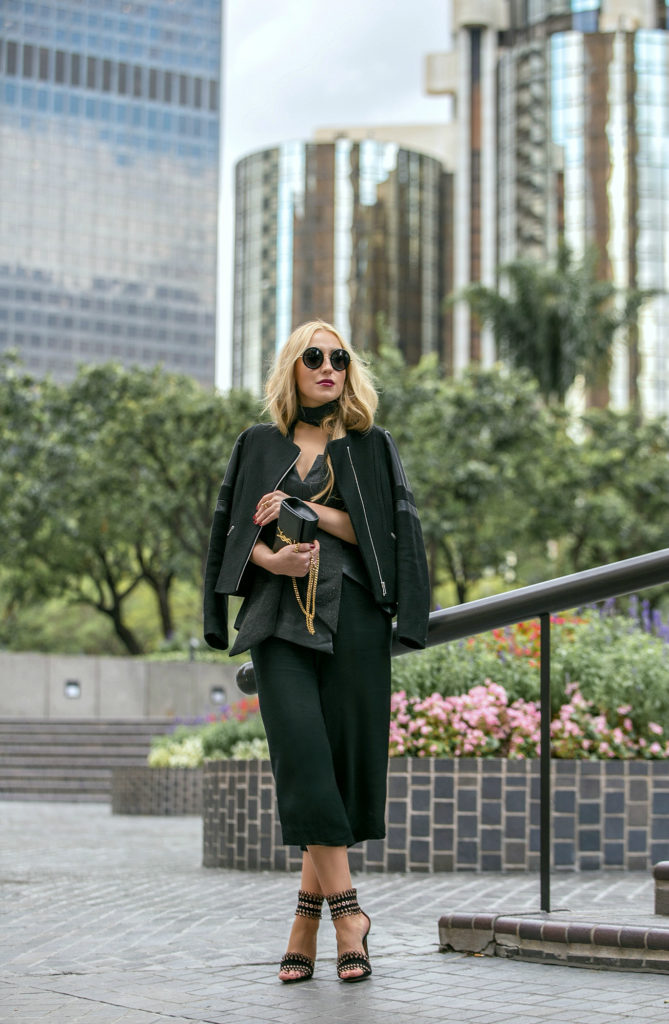 LA street style fashion,black minimalistic outfit,ALAIA heels,Alaia Sandals,Culottes outfit,YSL MONOGRAM BAG,How to wear culottes,the row sound sunglasses,finders keepers bustier,dolan t-shirt,dior fluid stick in Trompe L'Oeil,Sandro jacket,ysl bag,saint laurent bag