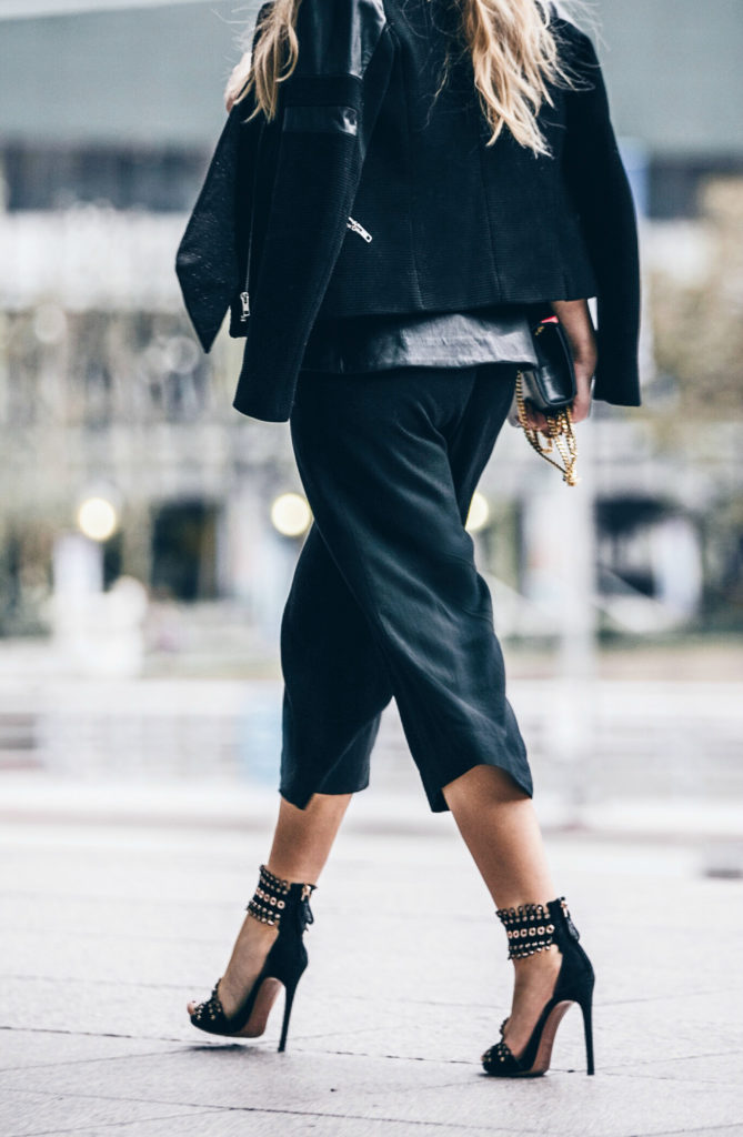 black minimalistic outfit,ALAIA heels,Alaia Sandals,Culottes outfit,YSL MONOGRAM BAG,How to wear culottes,the row sound sunglasses,finders keepers bustier,dolan t-shirt,dior fluid stick in Trompe L'Oeil,Sandro jacket,ysl bag,saint laurent bag