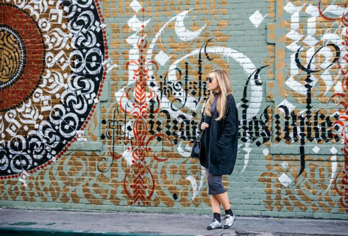 chunky cardigan outfit,how to wear loafers with skirt,How to style chunky cardigan,chanel lace up loafers,Chanel black bag,cardigan outfit,cardigan outfit idea,Prada earrings,Chanel loafers,row 8 sunglasses,Prada ball earrings,wolford leonie socks,chanel salzburg