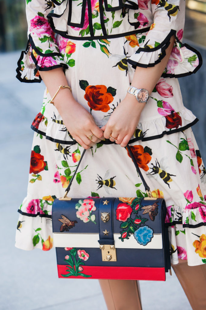 Gucci bow dress,How to wear floral print in winter,Gucci look,Gucci midi dress,Gucci buckle boots and floral bag,Gucci bow,Gucci floral bag,Gucci boots,Gucci cat lock bag and boots,gucci floral bow detail,Gucci lock bag,Gucci dress and boots,Gucci padlock flower bag,Gucci floral dress,Gucci flower dress,Gucci flower print dress,Gucci Christmas loo,Jolly and Bright