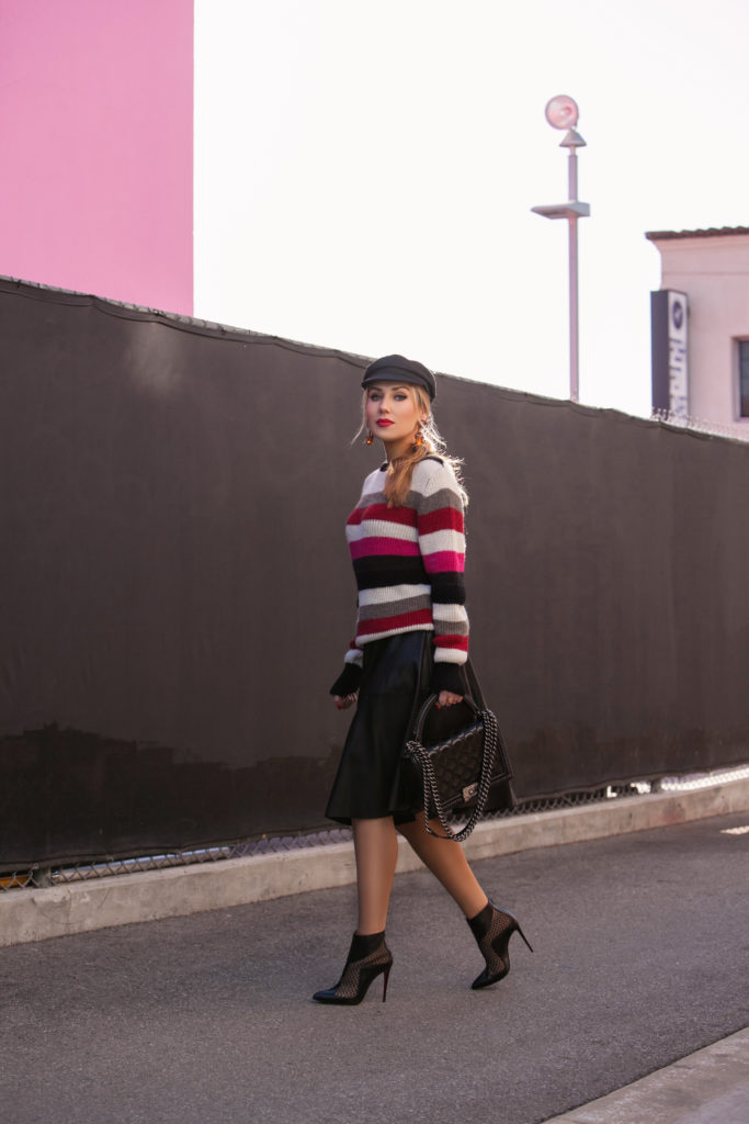 LA lips wall,christian louboutin lace boots,chanel bag,isabel marant evie flanel hat,Christian louboutin boots with lace,mac ruby woo,christian louboutin lace and leather booties,Iro solal sweater,zara leather skirt,Bright stripe sweater,how to style cadet hat,Chanel bag and christian louboutin boots,Iro and Isabel Marant look,christian louboutin booties