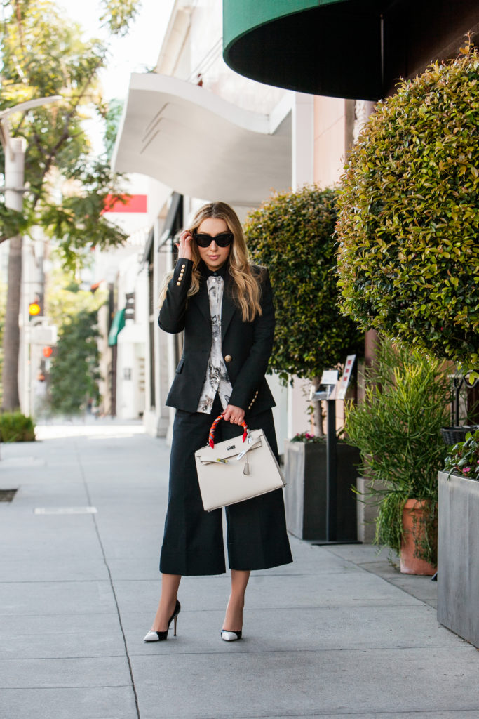 Balmain one button blazer,tibi culottes,how to wear pants suit,Balmain Blazer,Stella McCartney Cat Print Silk Blouse,Celine sunglasses,Hermes Twilly,how to tie hermes twilly,Hermes Kelly bag,Gianvitto Rossi Pumps,Celine cat eye sunglasses