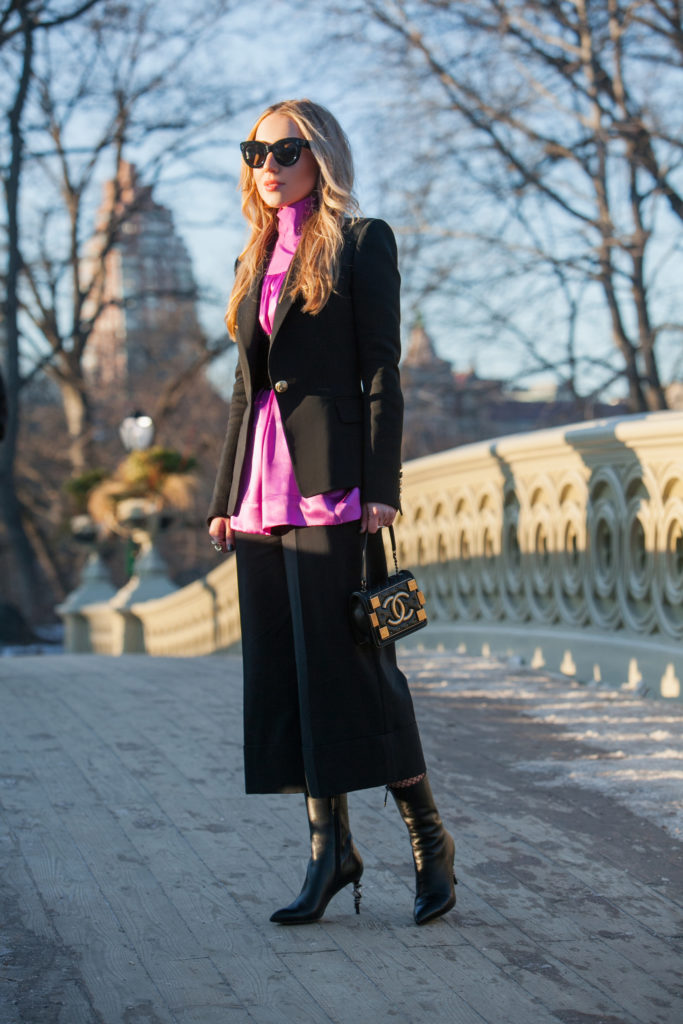 Alaia Laser cut belt,Bow bridge NYC,Bow Bridge view in Central Park,Central Park bow bridge NYC,Chanel boy brick bag,Central Park Bow bridge,Celine satin blouse,Central Park NYFW17,tibi culottes,Fashion photoshoot in Central Park,Alaia Belt,Balmain Blazer,Culottes with blazer,NYFW Central Park,Central Park photo shoot,NYFW17 street style,Alaia Vienne belt,Purple Celine silk blouse,Chanel gold earrings,Boots with fishnets