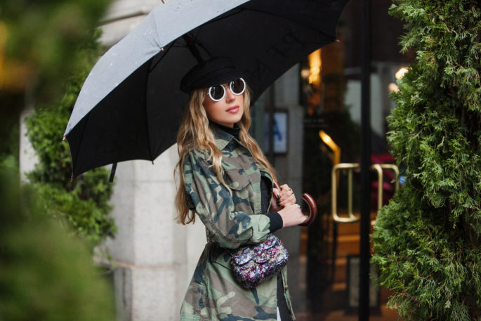 Rainy day fashion,topshop camo jacket,how to wear camo and sequins,nyfw 2017,NYFW street style,the row 8 sunglasses,NYC taxi,nyfw17,how to mix camouflage and floral print,prada flower print dress,NYFW17 street style,camo and sequins,chanel sequin bag,dior boots,topshop camouflage,topshop jacket,NYC view from the window,dior white boots,chanel camo sequin bag,marni belt,dior patent leather boots