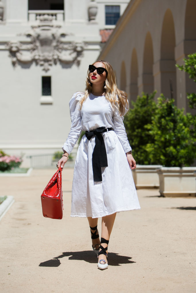 Proenza Schouler cutout mules,Alaia Vienne laser-cut leather tote,how to wear oversized sleeves,Alaïa Vienne tote,summer white outfit,H&M denim skirt,Alaïa Vienne tote bag,Zara BOW STRIPED BLOUSE,Zara STRIPED BLOUSE WITH BOW,Alaïa red Vienne bag,Zara bow top detail,Proenza Schouler strappy mules,Zara puff sleeves blouse,ZARA BOW top,How to wear Voluminous-Sleeve Shirt