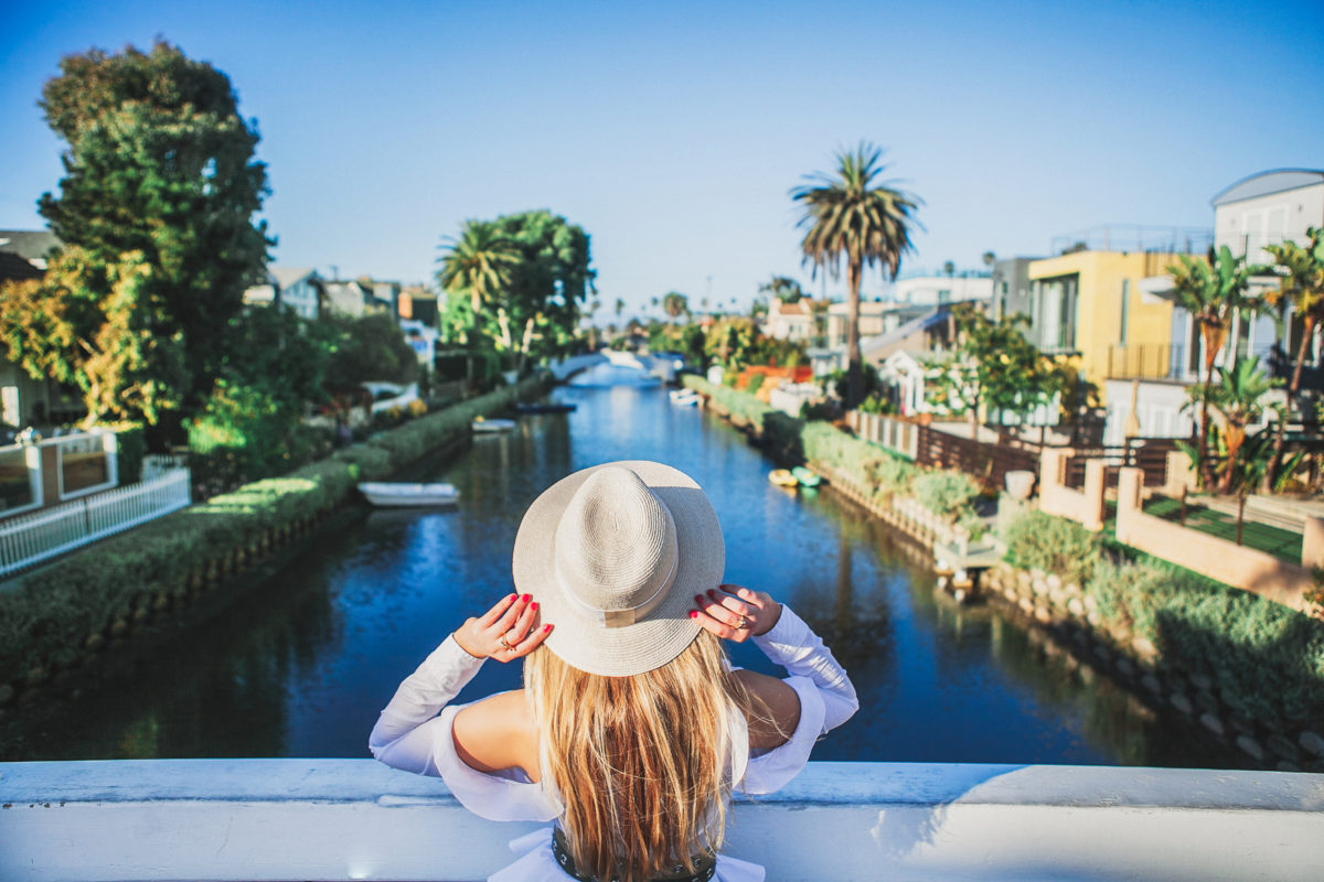 Venice canals view from the bridge,Venice Canals,Venice Canals colors,Maison michel straw hat,Venice canals pastels,balenciaga basket tote,Balenciaga straw bag,Venice canals bridges,Milly palm tree skirt,Jonathan Simkhai cold shoulder top,Venice canals California,Natural beige straw Henrietta hat from Maison Michel,Milly Palm Tree Print Cady Midi Skirt,Pretty venice canals,Colorful venice canals,balenciaga panier basket tote,Proenza Schouler's cutout mules,Balenciaga Bistro Cabas