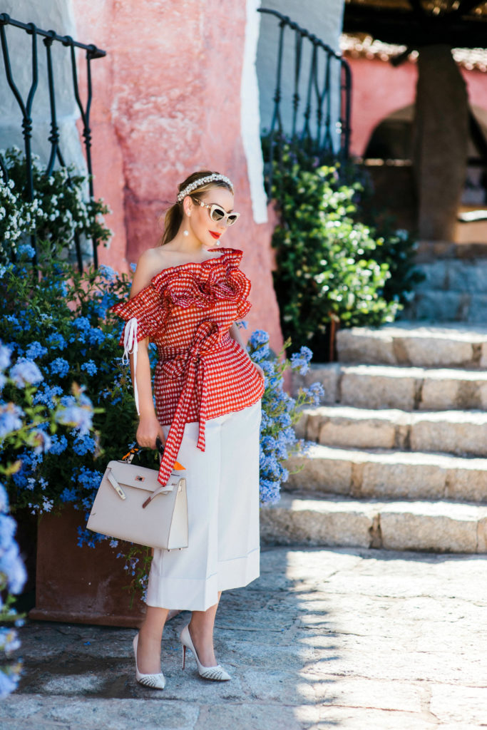 Rosie Assoulin Iris gingham seersucker top,Rosie Assoulin Iris seersucker top,ROSIE ASSOULIN top,maison michelle pearl headband,Hermes Kelly bag,christian louboutin white spike pumps,Sardinia Cala di volpe,How to wear culottes,Tibi culottes,Rosie Assoulin Iris off the shoulder ruffled gingham seersucker top,ROSIE ASSOULIN gingham top,Cala di volpe hotel,ROSIE ASSOULIN gingham ruffled top,Rosie Assoulin Iris off-the-shoulder gingham seersucker top,Rosie Assoulin seersucker top,Rosie Assoulin Iris top,Sardinia Cala di Volpe,Porto Cervo,Sardinia Porto Cervo